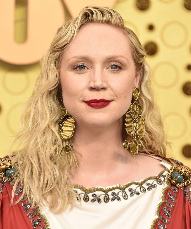 "<p>The <i>Game of Thrones </i>star went for a regal vibe on the red carpet with uber-dewy skin, red lipstick, and loose wavy hair. TRESemmé Celebrity Stylist John D used<a href=""http://linksynergy.walmart.com/deeplink?id=93xLBvPhAeE&mid=2149&murl=https%3A%2F%2Fwww.walmart.com%2Fip%2FTRESemm-TRES-Two-Hair-Mousse-Extra-Hold-15-oz%2F20595021&u1=IS%2CEmmy%2527sBeauty2019-GwendolineChristie-Slide%2Ckchiello1271%2C%2CIMA%2C3481964%2C201909%2CI"" target=""_blank""> TRESemmé's Extra Hold Mousse</a> to bring out Christie's natural wave pattern. </p>"