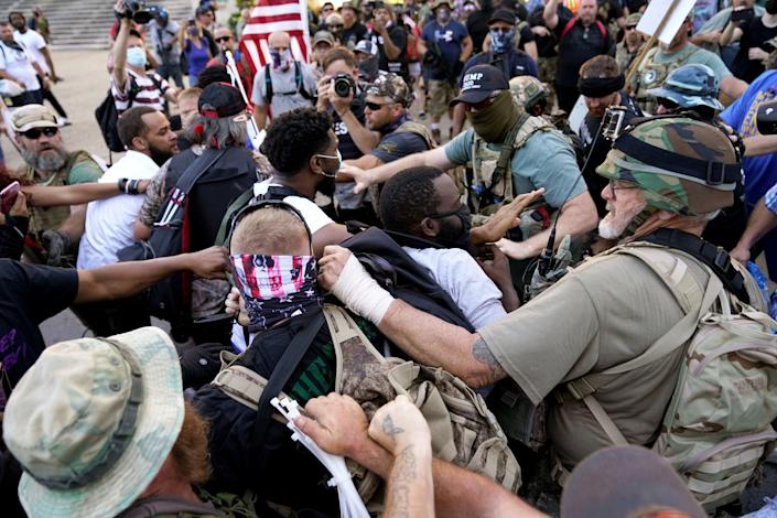 Image: Far-right activists confront Black Lives Matter activists in Louisville (Bryan Woolston / Reuters)
