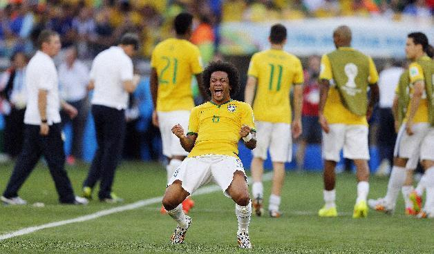 10ThingstoSeeSports - Brazil's Marcelo celebrates after the World Cup round of 16 soccer match between Brazil and Chile at the Mineirao Stadium in Belo Horizonte, Brazil, Saturday, June 28, 2014. Brazil won 3-2 on penalties. (AP Photo/Frank Augstein, File)