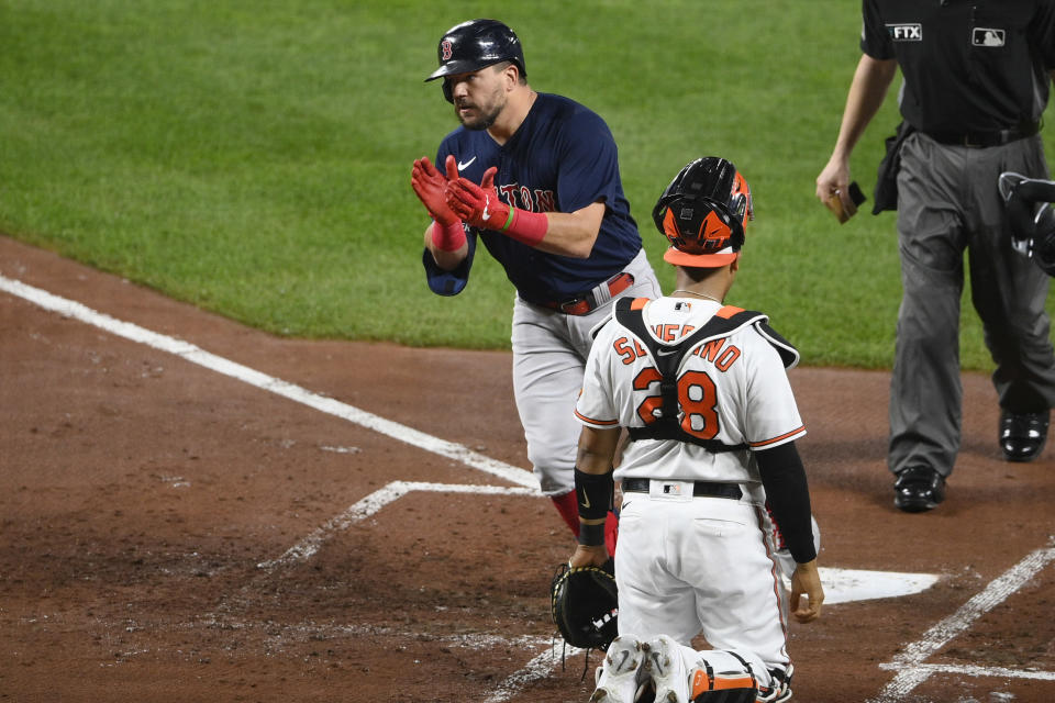 Boston Red Sox' Kyle Schwarber, top left, celebrates his home run during the second inning of a baseball game next to Baltimore Orioles catcher Pedro Severino (28), Tuesday, Sept. 28, 2021, in Baltimore. (AP Photo/Nick Wass)