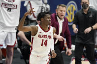 Alabama's Keon Ellis (14) celebrates after scoring against LSU during the second half of the championship game at the NCAA college basketball Southeastern Conference Tournament Sunday, March 14, 2021, in Nashville, Tenn. (AP Photo/Mark Humphrey)