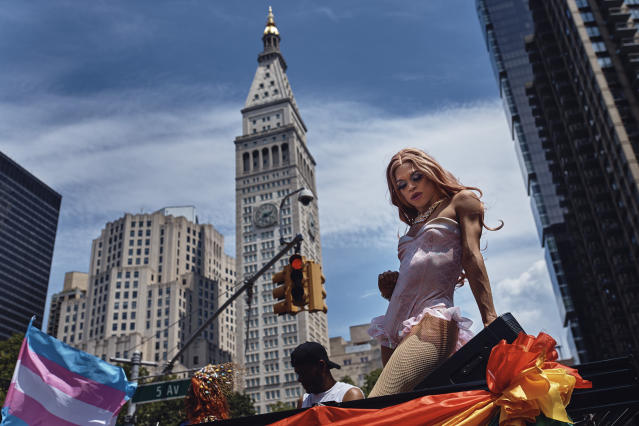 <p>A reveler performs as a float moves along Fifth Avenue during the New York City Pride Parade on Sunday, June 24, 2018, in New York. (Photo: Andres Kudacki/AP) </p>