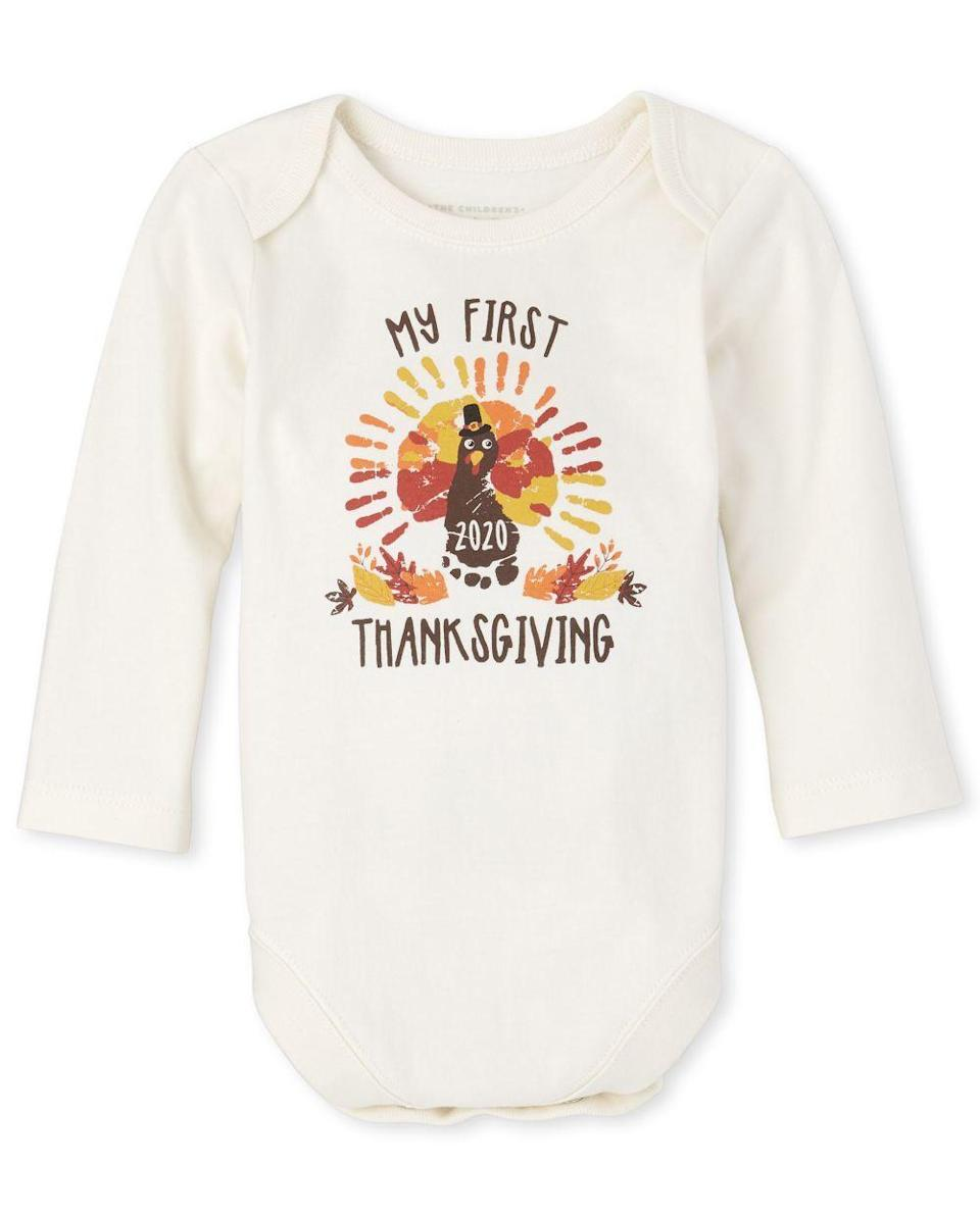 """<p><strong>The Children's Place</strong></p><p>childrensplace.com</p><p><strong>$5.99</strong></p><p><a href=""""https://go.redirectingat.com?id=74968X1596630&url=https%3A%2F%2Fwww.childrensplace.com%2Fus%2Fp%2FUnisex-Baby-Long-Sleeve--My-First-Thanksgiving--Graphic-Bodysuit-3015304-32DX&sref=https%3A%2F%2Fwww.goodhousekeeping.com%2Fholidays%2Fthanksgiving-ideas%2Fg23100250%2Fbest-baby-thanksgiving-outfits%2F"""" rel=""""nofollow noopener"""" target=""""_blank"""" data-ylk=""""slk:Shop Now"""" class=""""link rapid-noclick-resp"""">Shop Now</a></p><p>Your baby might be too young to do a hand turkey without help, but this graphic, long-sleeved bodysuit embodies the spirit of the iconic craft. It even has the year emblazoned on it.</p>"""