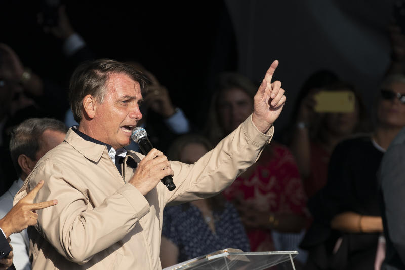 Brazil's President Jair Bolsonaro speaks at an International Grace of God Church event, at Botafogo beach in Rio de Janeiro, Brazil, Saturday, Feb. 15, 2020. Tens of thousands of people gathered to celebrated the 40th anniversary of the evangelical church. (AP Photo/Leo Correa)