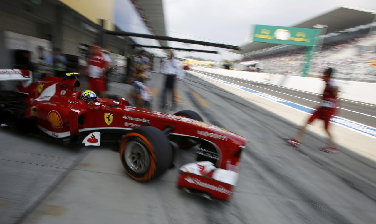 Ferrari Formula One driver Felipe Massa of Brazil drives out of his garage during the third practice session of the Japanese F1 Grand Prix at the Suzuka circuit October 12, 2013. REUTERS/Issei Kato (JAPAN - Tags: SPORT MOTORSPORT F1 TPX IMAGES OF THE DAY)