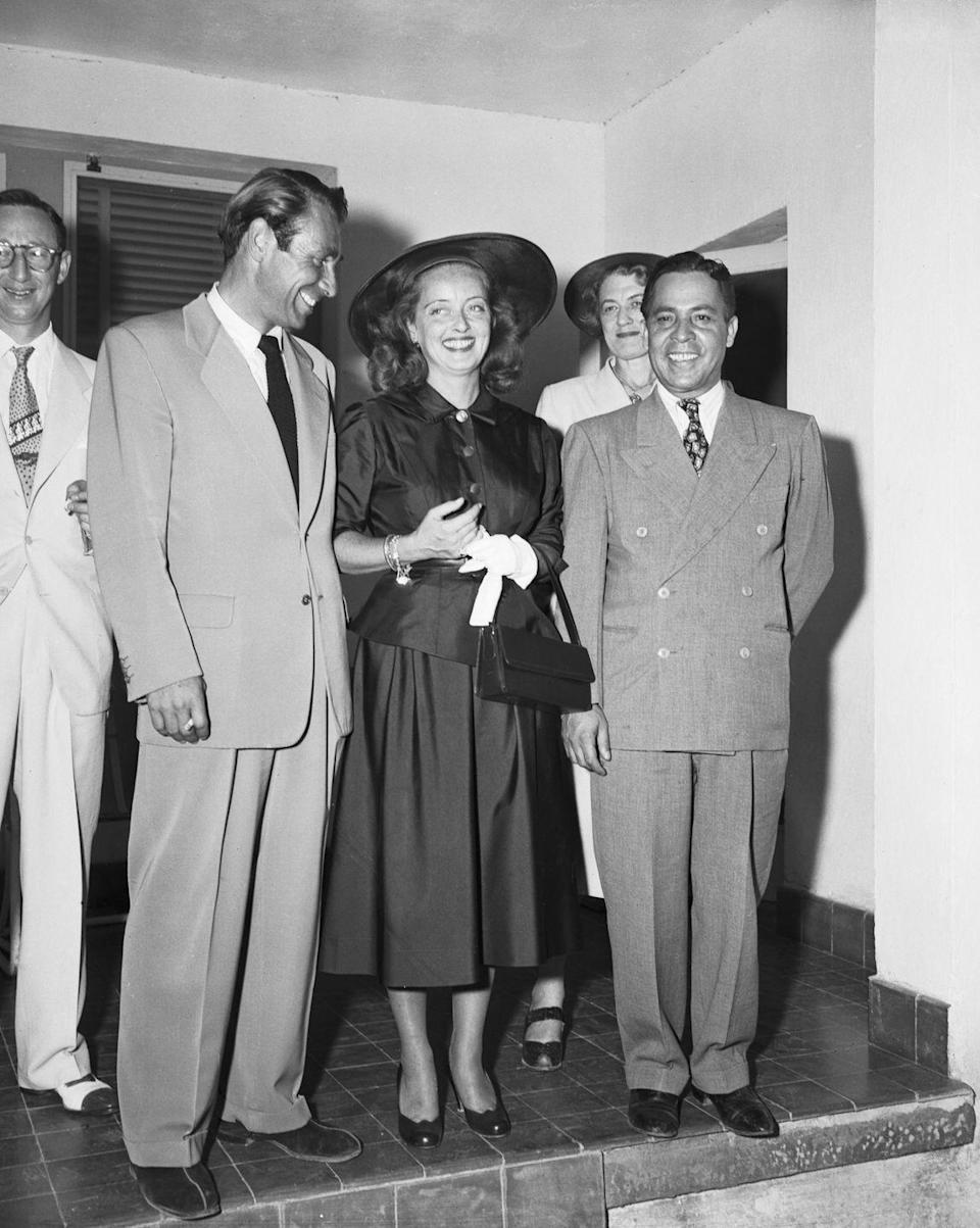 <p>Bette Davis wore an all-black satin skirt suit to her fourth and final marriage in 1950. The Hollywood starlet married her <em>All About Eve</em> costar, Gary Merrill, in a small ceremony in Juarez, Mexico.</p>
