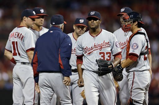 Washington Nationals starting pitcher Edwin Jackson (33) walks off the field after being pulled out of the baseball game during the second inning against the St. Louis Cardinals on Friday, Sept. 28, 2012, in St. Louis. (AP Photo/Jeff Roberson)