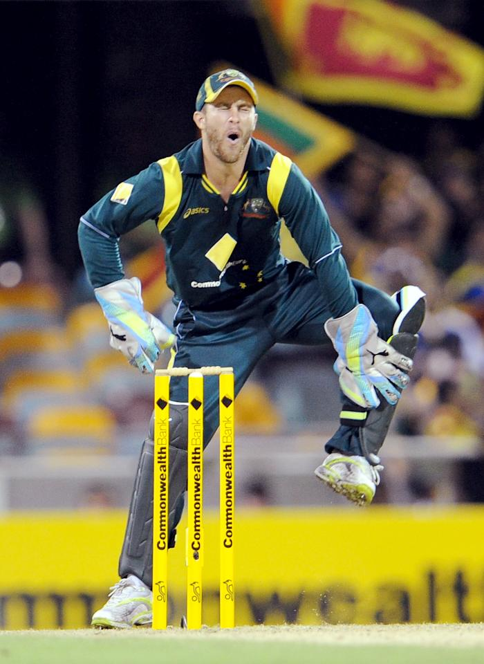 Australian wicketkeeper Matthew Wade hobbles after been hit by the ball in the first international one-day cricket final at the Gabba in Brisbane, on March 4, 2012.