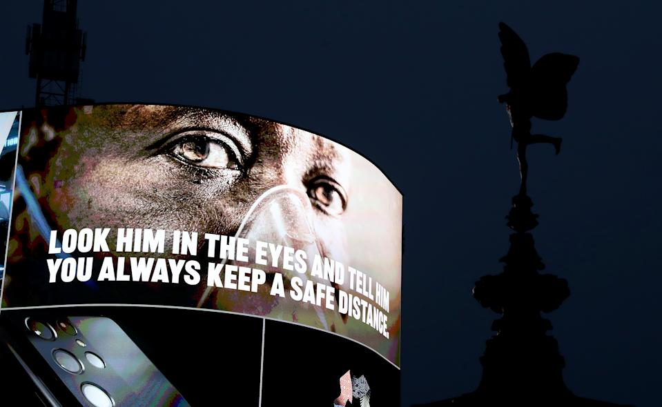 LONDON, ENGLAND - FEBRUARY 03: Covid-19 messaging is seen on the advertising hoarding at Piccadilly Circus during the UK's third national lockdown on February 03, 2021 in London, England . (Photo by Chris Jackson/Getty Images)