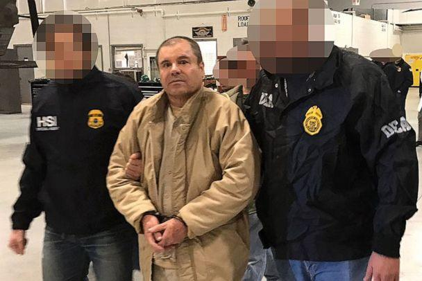 PHOTO: Joaquin Guzman Loera aka 'El Chapo' Guzman (C) is escorted in Ciudad Juarez by the Mexican police as he is extradited to the United States. (via AFP/Getty Images, FILE)