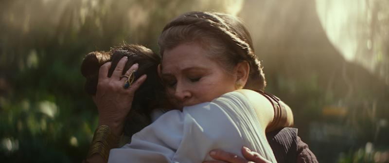 Leia Organa (Carrie Fisher) embraces Rey (Daisy Ridle) in Star Wars: The Rise Of Skywalker (PHOTO: Walt Disney Studios)