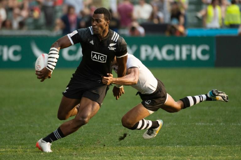 New Zealand's Joe Ravouvou (L) is tackled during their match against Fiji at the Hong Kong Rugby Sevens tournament