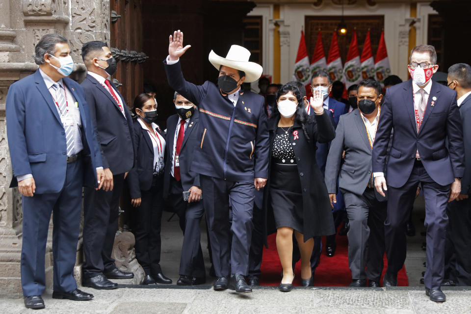 Peru's President-elect Pedro Castillo and his wife Lilia Paredes wave as they leave the Foreign Ministry to go to Congress for his swearing-in ceremony on his Inauguration Day in Lima, Peru, Wednesday, July 28, 2021. (AP Photo/Guadalupe Pardo)
