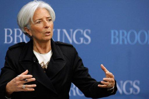 "The US and the IMF welcomed China's decision to widen the trading band on the nation's currency, while analysts downplayed Sunday the likelihood of wide swings in the value of the yuan. IMF chief Christine Lagarde (pictured on April 12) described the move on the yuan as an ""important step."""