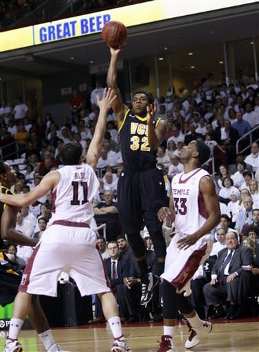 VCU's Melvin Johnson (32) shoot over Temple's T. J. DiLeo (11) and Scootie Randall (33) in the first half of an NCAA College basketball game, Sunday, March 10, 2013, in Philadelphia. (AP Photo/H. Rumph Jr)