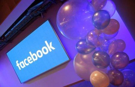 FILE PHOTO - Balloons are seen in front of a logo at Facebook's headquarters in London, Britain, December 4, 2017. REUTERS/Toby Melville