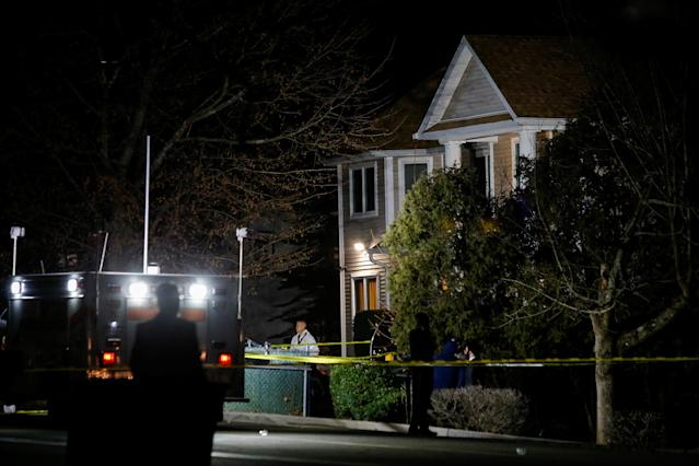 A police officer exits the house where five people were stabbed at a Hasidic rabbi's home in Monsey, New York (Reuters)