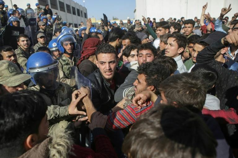 Hundreds of residents of the Syrian town of Al-Bab protested outside  police headquarters after the arrest of a suspect in a car bombing