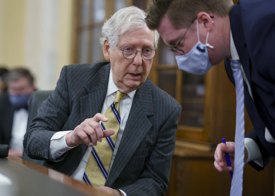 "Senate Minority Leader Mitch McConnell, R-Ky., turns to an aide as the Senate Rules Committee holds a hearing on the ""For the People Act,"" which would expand access to voting and other voting reforms, at the Capitol in Washington, Wednesday, March 24, 2021. The bill has already passed in the House. (AP Photo/J. Scott Applewhite)"