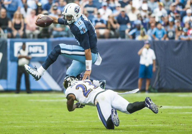 <p>Tennessee Titans quarterback Marcus Mariota (8) avoids a tackle attempt by Baltimore Ravens strong safety Tony Jefferson (23) during an NFL football game on Sunday, Nov. 5, 2017, in Nashville, Tenn. The Titans won 23-20. (Austin Anthony/Daily News via AP) </p>