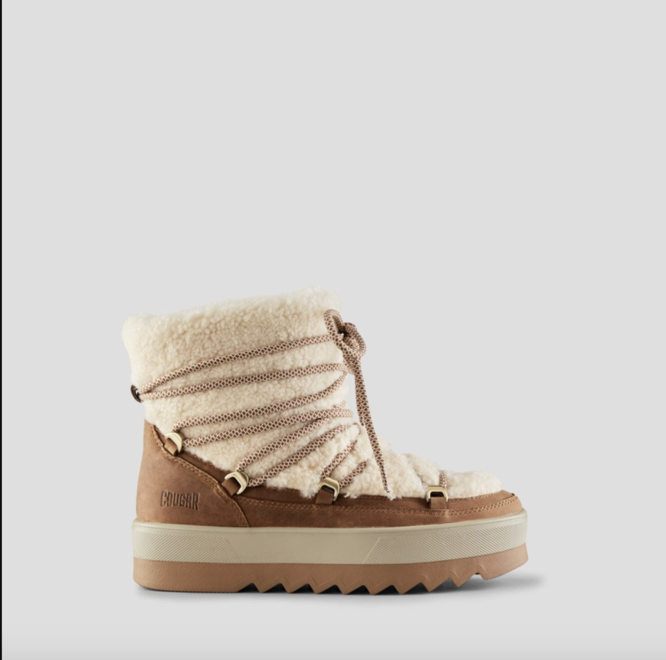 """<p><strong>Cougar</strong></p><p>cougarshoes.com</p><p><strong>$220.00</strong></p><p><a href=""""https://www.cougarshoes.com/product/verity-shearling-winter-boot/black/"""" rel=""""nofollow noopener"""" target=""""_blank"""" data-ylk=""""slk:SHOP IT"""" class=""""link rapid-noclick-resp"""">SHOP IT </a></p><p>This waterproof pair is a must-have for the colder months. </p>"""