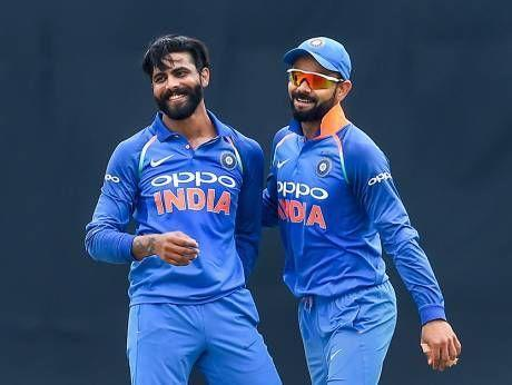 Jadeja (left) celebrates with Indian captain Kohli (right) after picking up a wicket against the West Indies in the 5th ODI