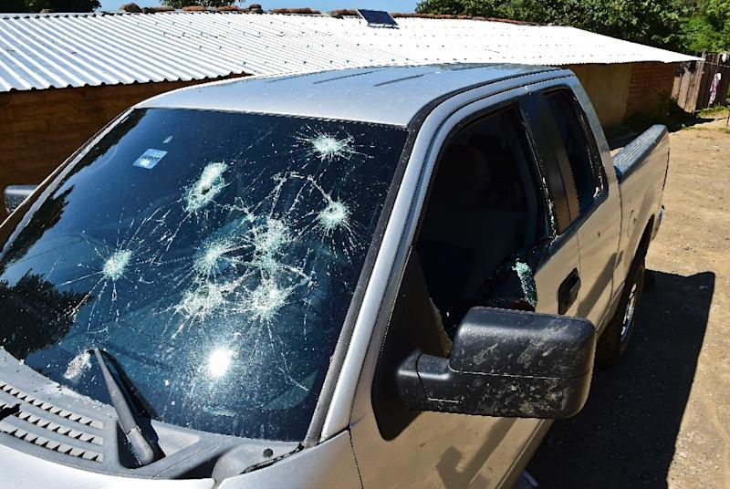 """A truck damaged by gunfire is pictured at the El Aguila ranch, in Durango State, on October 18, 2015, after dozens of bullets hit civil cars and houses during a Marine operation chasing fugitive drug kingpin Joaquin """"""""El Chapo"""""""" Guzman (AFP Photo/Ronaldo Schemidt)"""
