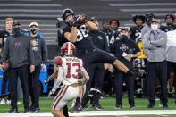 Iowa State tight end Charlie Kolar (88) makes the catch in front of Oklahoma defensive back Tre Norwood (13) during the first half of the the Big 12 Conference championship NCAA college football game, Saturday, Dec. 19, 2020, in Arlington, Texas. (AP Photo/Jeffrey McWhorter)
