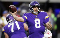 FILE -In this Aug. 27, 2017, file photo, Minnesota Vikings quarterback Sam Bradford throws a pass during the first half of an NFL preseason football game against the San Francisco 49ers in Minneapolis. The Arizona Cardinals have addressed their dire need at quarterback after signing Sam Bradford, though they may not be done at the position. Bradford, the No. 1 overall pick in the 2010 draft, is known for his strong and accurate arm, but he has struggled with injuries. (AP Photo/Jim Mone, File)