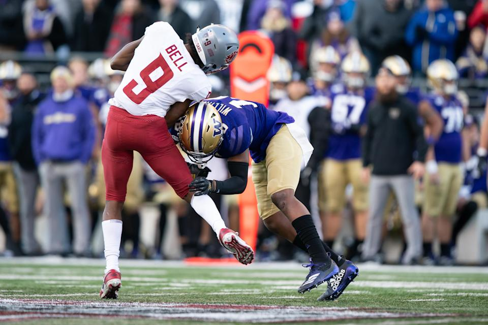 SEATTLE, WA - NOVEMBER 29: Washington State Cougars wide receiver Renard Bell (9) is hit hard by Washington Huskies defensive back Elijah Molden (3) after a reception in the second half of the 112th Apple Cup between the Washington Huskies and the Washington State Cougars on Friday, November 29, 2019 at Husky Stadium in Seattle, WA. (Photo by Christopher Mast/Icon Sportswire via Getty Images)
