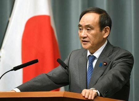 Japan's Chief Cabinet Secretary Yoshihide Suga speaks to media during a news conference after the reports on the launch of a North Korean missile in Tokyo, Japan