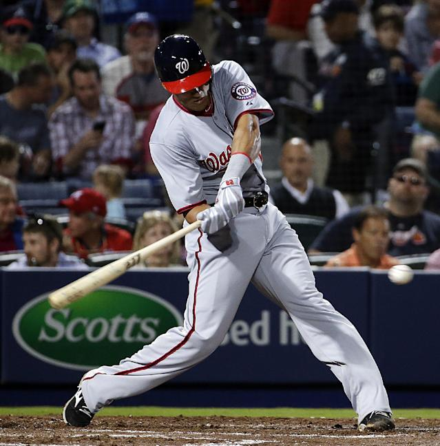 Washington Nationals' Ian Desmond swings to hit a single to score teammate Adam LaRoche in the fourth inning of a baseball game against the Atlanta Braves, Friday, April 11, 2014, in Atlanta. (AP Photo/David Goldman)