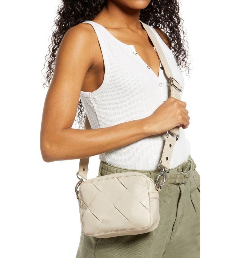 <p>The <span>Topshop Woven Leather Crossbody Bag</span> ($75) is so versatile and easy to wear.</p>