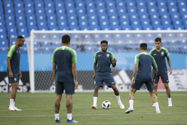 Brazil's Fred, center, controls the ball during Brazil's official training on the eve of the group E match between Brazil and Switzerland at the 2018 soccer World Cup in the Rostov Arena in Rostov-on-Don, Russia, Saturday, June 16, 2018. (AP Photo/Felipe Dana)