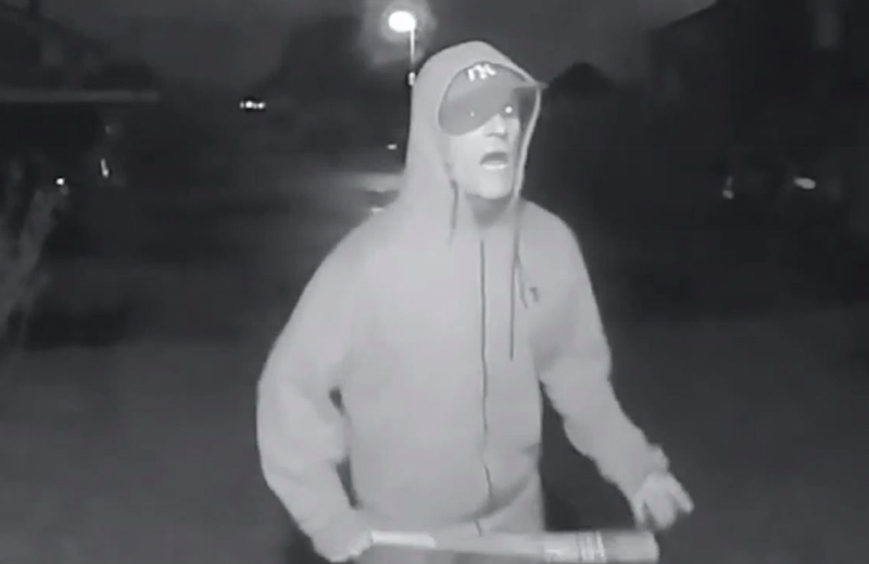 Vincent Fuller was caught on CCTV swinging a baseball bat outside a neighbour's house (Picture: PA)