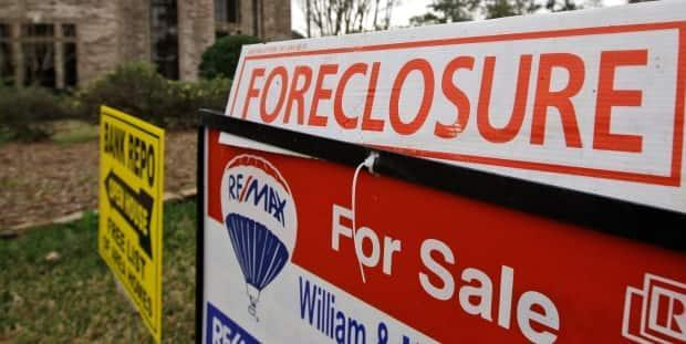 According to the disciplinary decision, Kevin Bratch targeted vulnerable people who were facing foreclosure with a rent to own scheme that was disadvantageous to owners. (David J. Phillip/Associated Press - image credit)