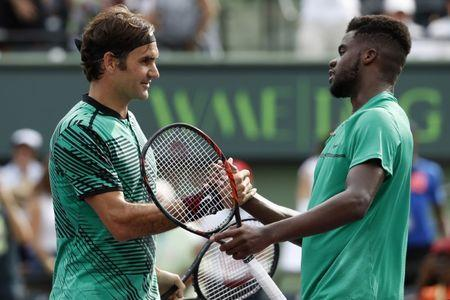Mar 25, 2017; Miami, FL, USA; Roger Federer of Switzerland (L) shakes hands with Frances Tiafoe of the United States (R) after their match on day five of the 2017 Miami Open at Crandon Park Tennis Center. Mandatory Credit: Geoff Burke-USA TODAY Sports