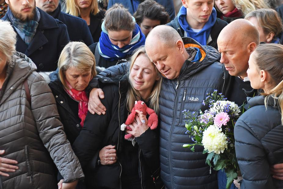 Leanne O'Brien, centre, the girlfriend of Jack Merritt, is comforted by family members during a vigil to honour both him and Saskia Jones (Picture: PA)
