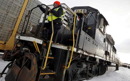FILE PHOTO: Woman steps off a train during her conductor trainee program at Norfolk Southern's Calumet Yard in Chicago