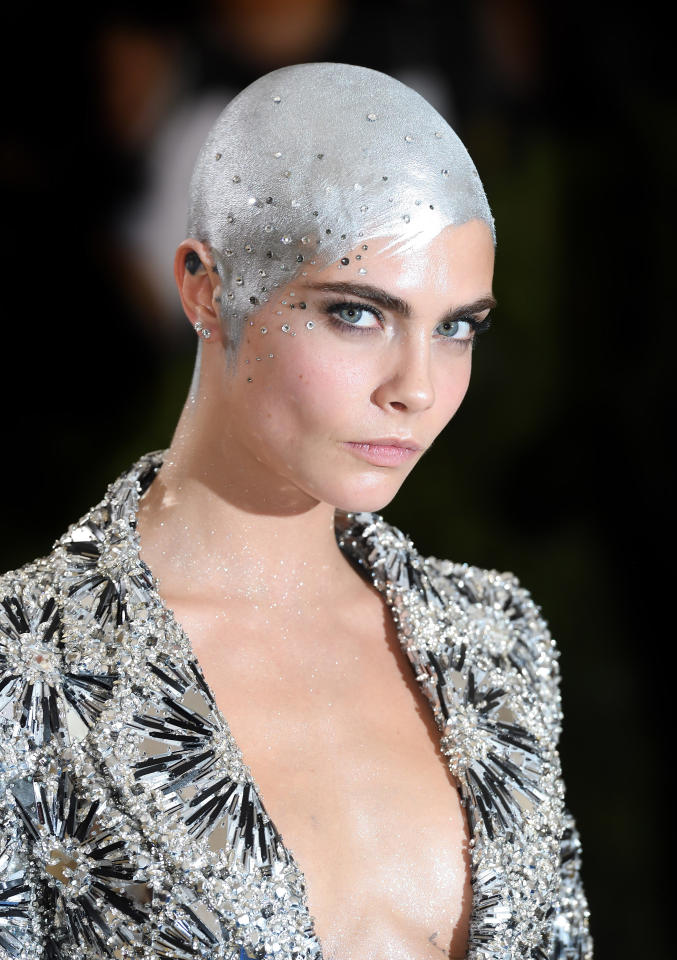 <p>Cara Delevingne once rocked a shining silver buzzcut, and this grown-out version is chic and sexy.(Photo: Getty Images) </p>
