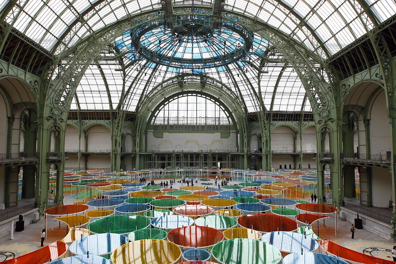 """View of the creation of contemporary artist Daniel Buren in the Grand Palais during the opening of ground-breaking Monumenta exhibit in Paris, Wednesday May 9, 2012. Monumenta, the hugely-popular annual installation project that's in its fifth year, dares an artist of international statue to """"move into"""" the nave of one of the French capital's most monumentus buildings, and own it. (AP Photo/Francois Mori)"""