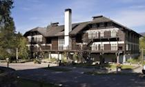 "<p>Designated a national historic landmark in 1987, <a href=""https://www.glaciernationalparklodges.com/lodging/lake-mcdonald-lodge/"" rel=""nofollow noopener"" target=""_blank"" data-ylk=""slk:Glacer Park's Lake McDonald Lodge"" class=""link rapid-noclick-resp"">Glacer Park's Lake McDonald Lodge</a> is one of the finest surviving examples of Swiss Chalet architecture in the country. It was built in 1913 based on architect Kirtland Cutter's design, and it features a stucco-covered stone foundation and first story, with dark wood clapboard and sawn trim patterns on the second and third stories. Inside the three story lobby, many of its original furnishings, including originals from Old Hickory and Stickley, as well as the hotel piano, are original.</p>"