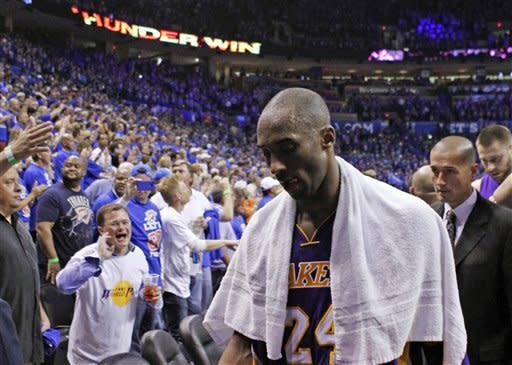 Los Angeles Lakers guard Kobe Bryant (24) walks off the court after their 106-90 loss to the Oklahoma City Thunder in Game 5 of their NBA basketball Western Conference semifinal playoff series, Monday, May 21, 2012, in Oklahoma City. The Thunder won the series 4-1. (AP Photo/Alonzo Adams)