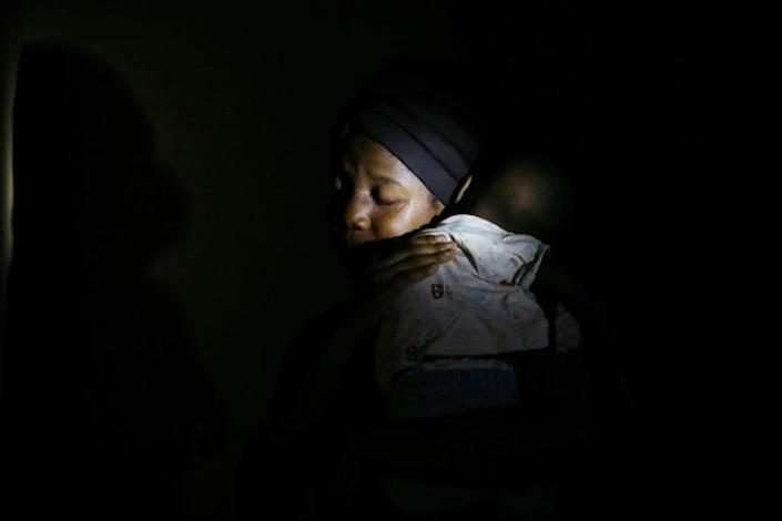 Amina Ahmed, wife of Mubarak Bala, an outspoken atheist who was charged with blasphemy, comforts her 1-year-old baby