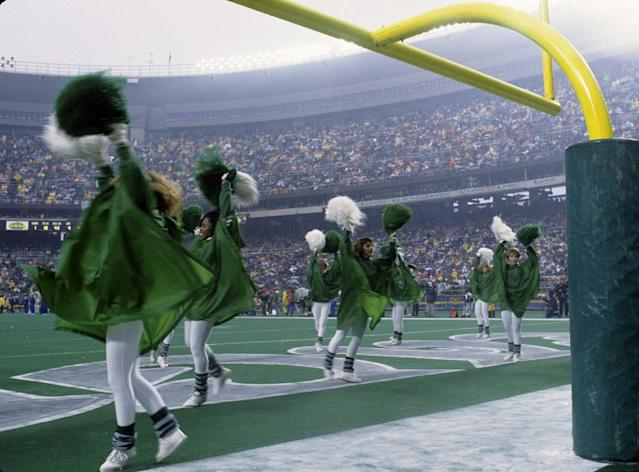 The Philadelphia Eagles cheerleaders perform in the rain during the Eagles 21-7 loss to the Los Angeles Rams in the 1989 NFC Wild Card Playoff Game on December 31, 1989 at Veterans Stadium in Philadelphia, Pennsylvania. (Photo by Al Messerschmidt/Getty Images)