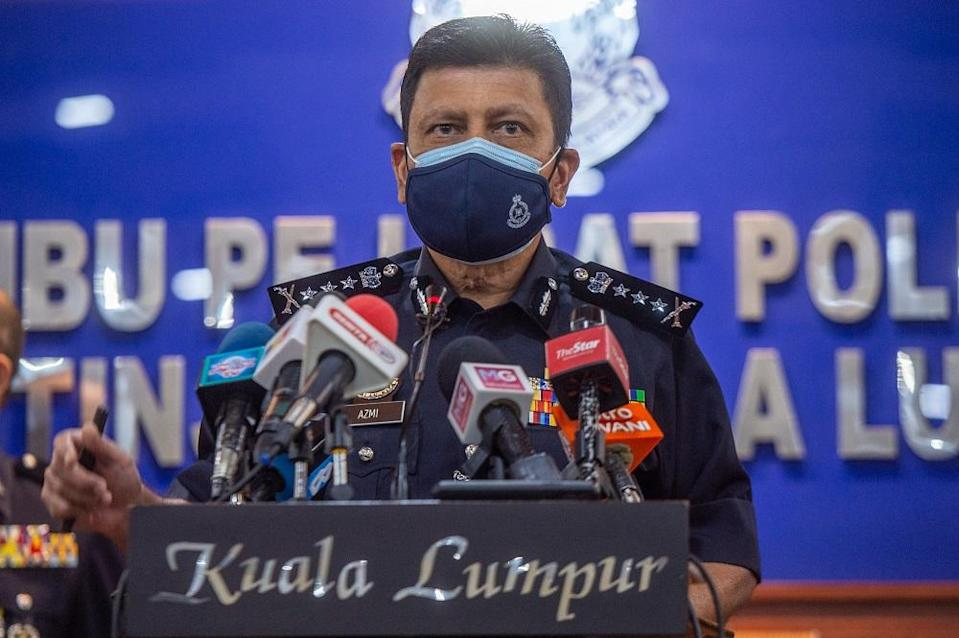 KL Police Chief Commissioner Datuk Azmi Abu Kassim speaks to reporters at Kuala Lumpur police headquarters June 11, 2021. — Picture by Shafwan Zaidon