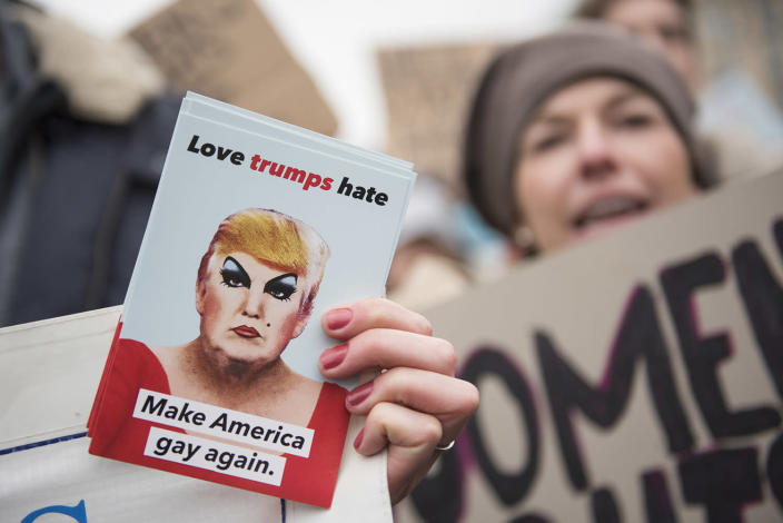 "<p>Women attend a protest for women's rights and freedom in solidarity with the Women's March on Washington with a sign that reads ""Love trumpf hate – make America gay again"" in front of Brandenburger Tor on January 21, 2017 in Berlin, Germany. (Photo by Steffi Loos/Getty Images) </p>"