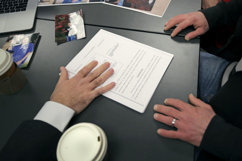 David Meehan, right, lead plaintiff in a class-action lawsuit accusing the State of New Hampshire of covering up decades of sexual, physical and emotional abuse at its youth detention center, reviews documents his attorney, Rus Rilee, in Portsmouth, N.H., Friday, Jan. 10, 2020. Meehan accuses three staffers, one who later worked for the Boston Red Sox, of sexually assaulting him and others of witnessing and enabling the abuse. (AP Photo/Charles Krupa)