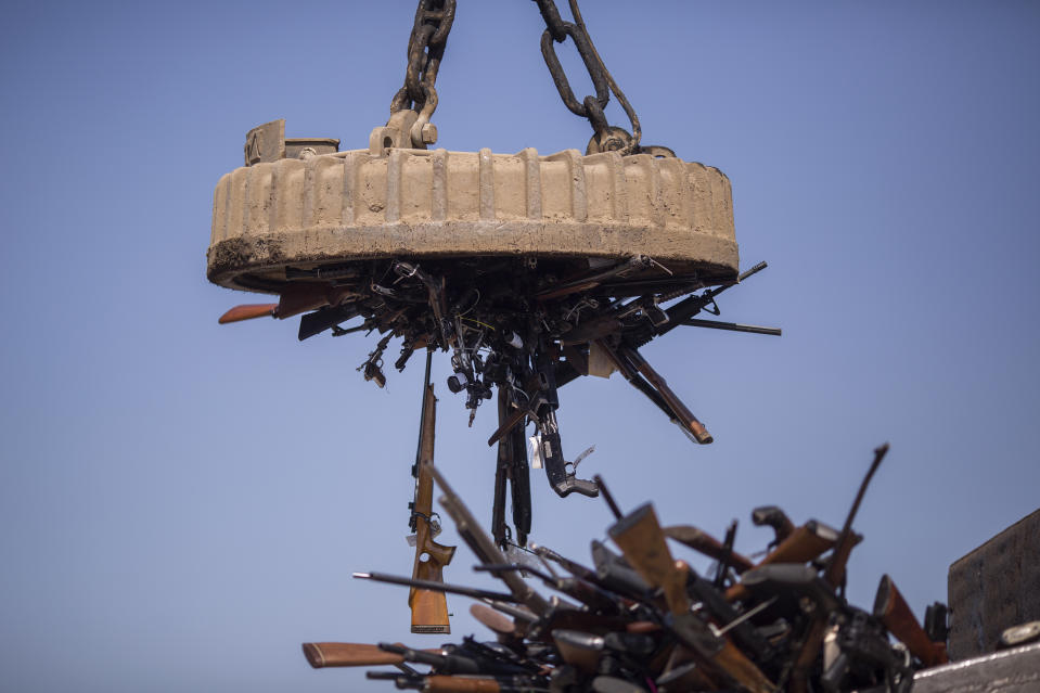 An electromagnet is used to pick up some of approximately 3,500 confiscated guns to be melted down at Gerdau Steel Mill on July 19, 2018 in Rancho Cucamonga, California. (Photo: David McNew/Getty Images)