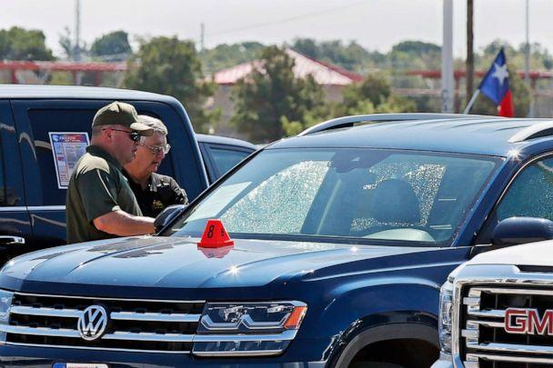 PHOTO: Officials at the scene in Odessa, Texas on Sept. 2, 2019, where teenager Leilah Hernandez was fatally shot at a car dealership during a shooting rampage that killed seven. (Sue Ogrocki/AP)